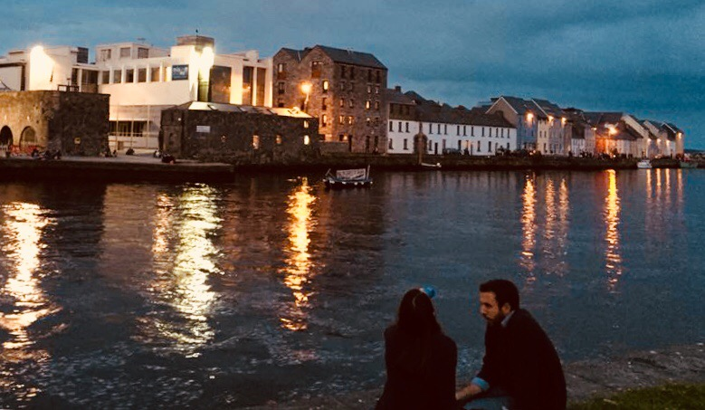 A young couple in Galway contemplate the evening